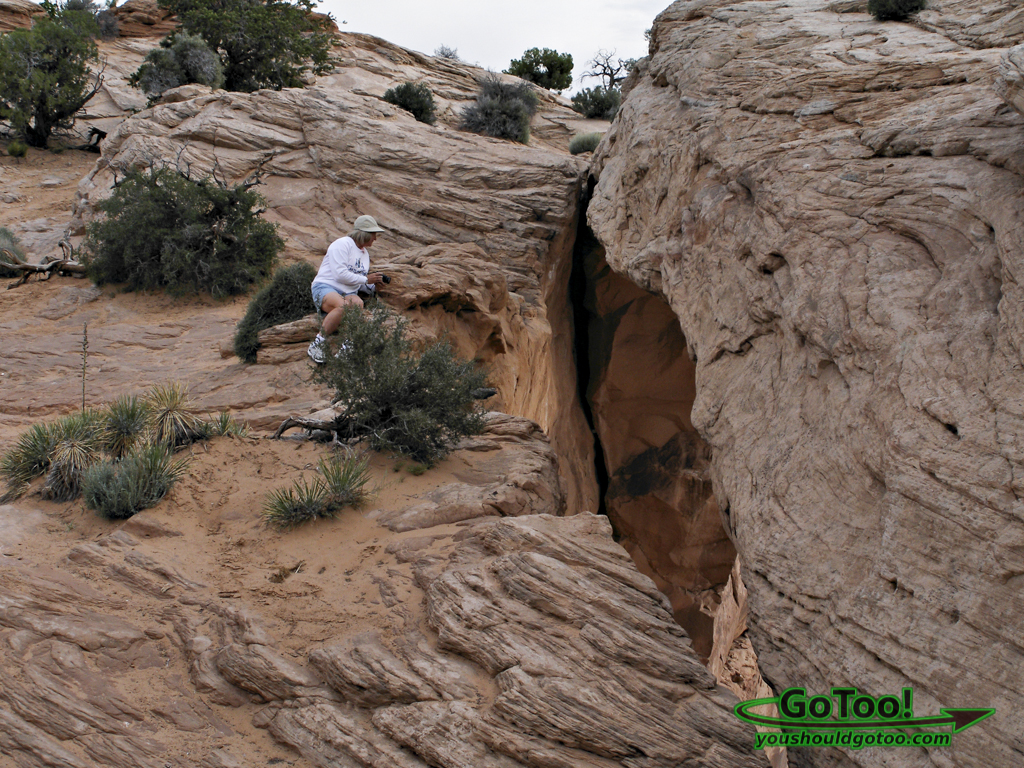 Peering Over Mesa Arch Pothole Arch